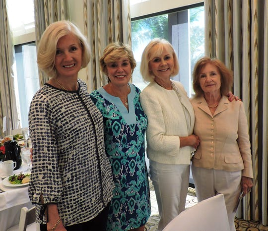 Erika Scherbaum, left, Ellen Moody, Susan Carnasiotis and Charlotte Richardson at Mary's Shelter's Fashion Show & Luncheon Jan.22 at Willoughby Golf Club in Stuart.