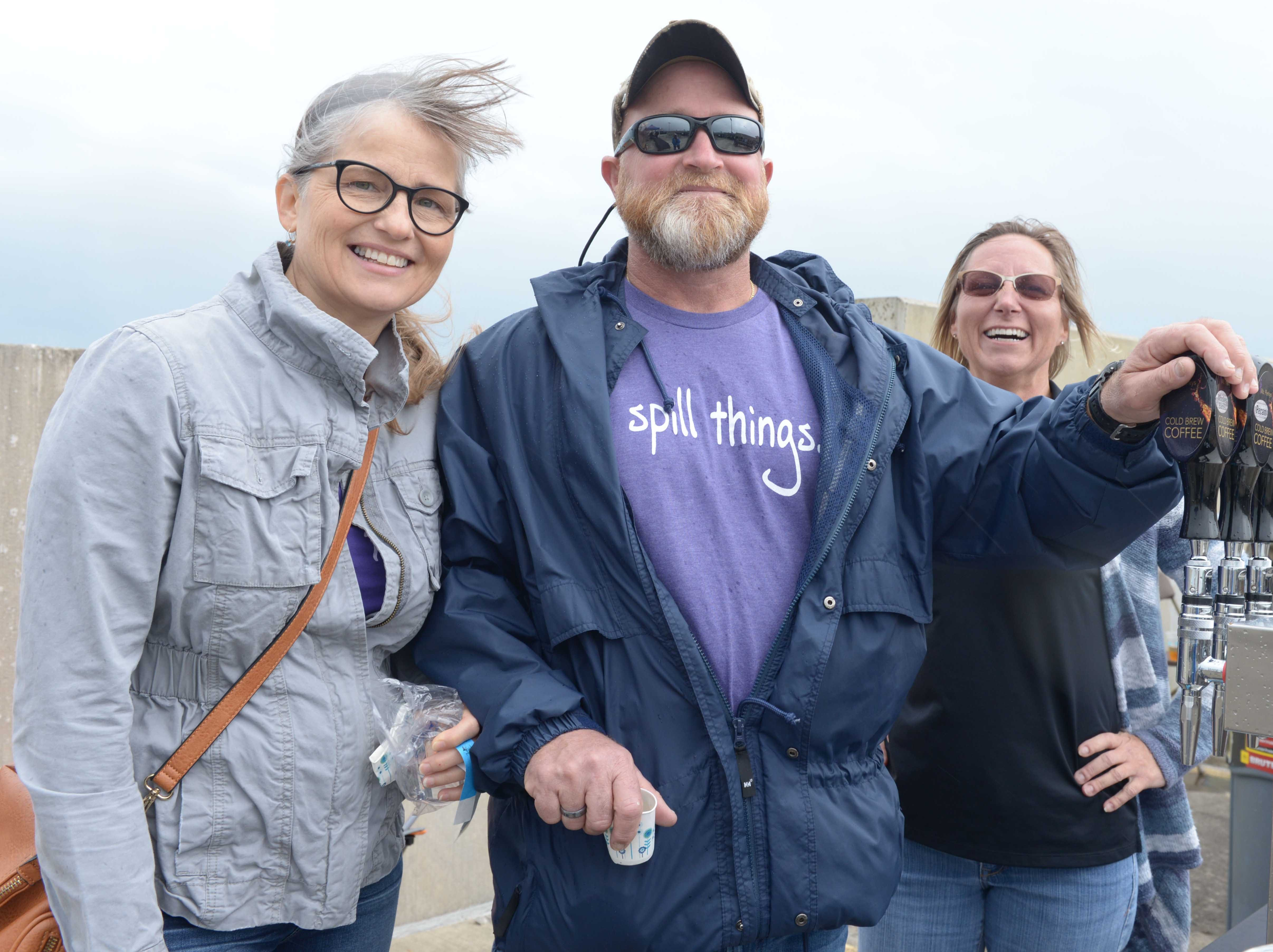 Sandy and Dana Carlile and Carol Alberts on the roof of the Fort Pierce City Parking Garage before the rain started for Bluebird Educational Foundation's Groovin' & Tastin' Sunrise City Wine & Spirits Fest.
