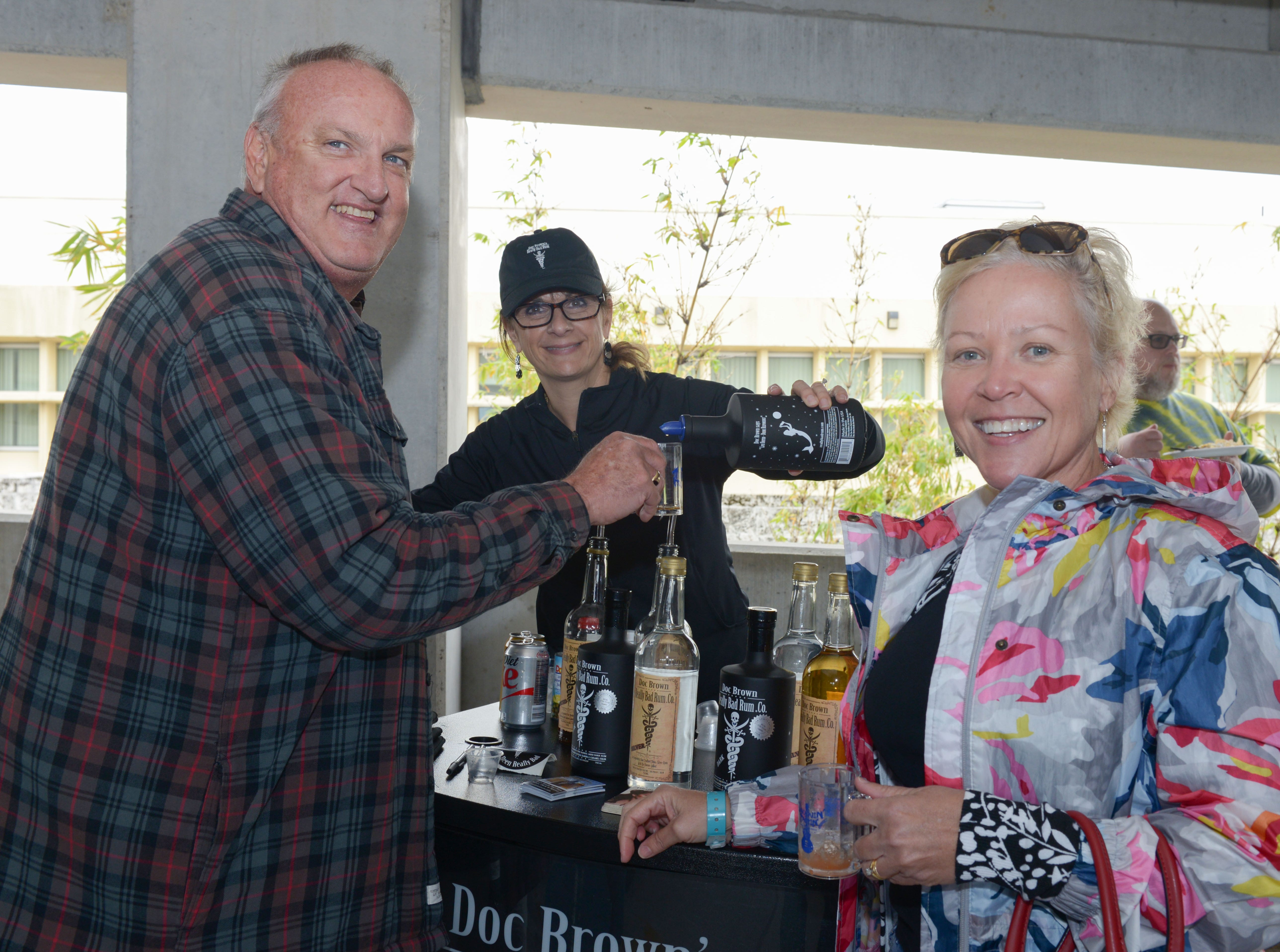 Richard and Gaby Radcliffe with Susan Brown, center, of Doc Brown's Really Bad Rum at Bluebird Educational Foundation's Groovin' & Tastin' Sunrise City Wine & Spirits Fest.