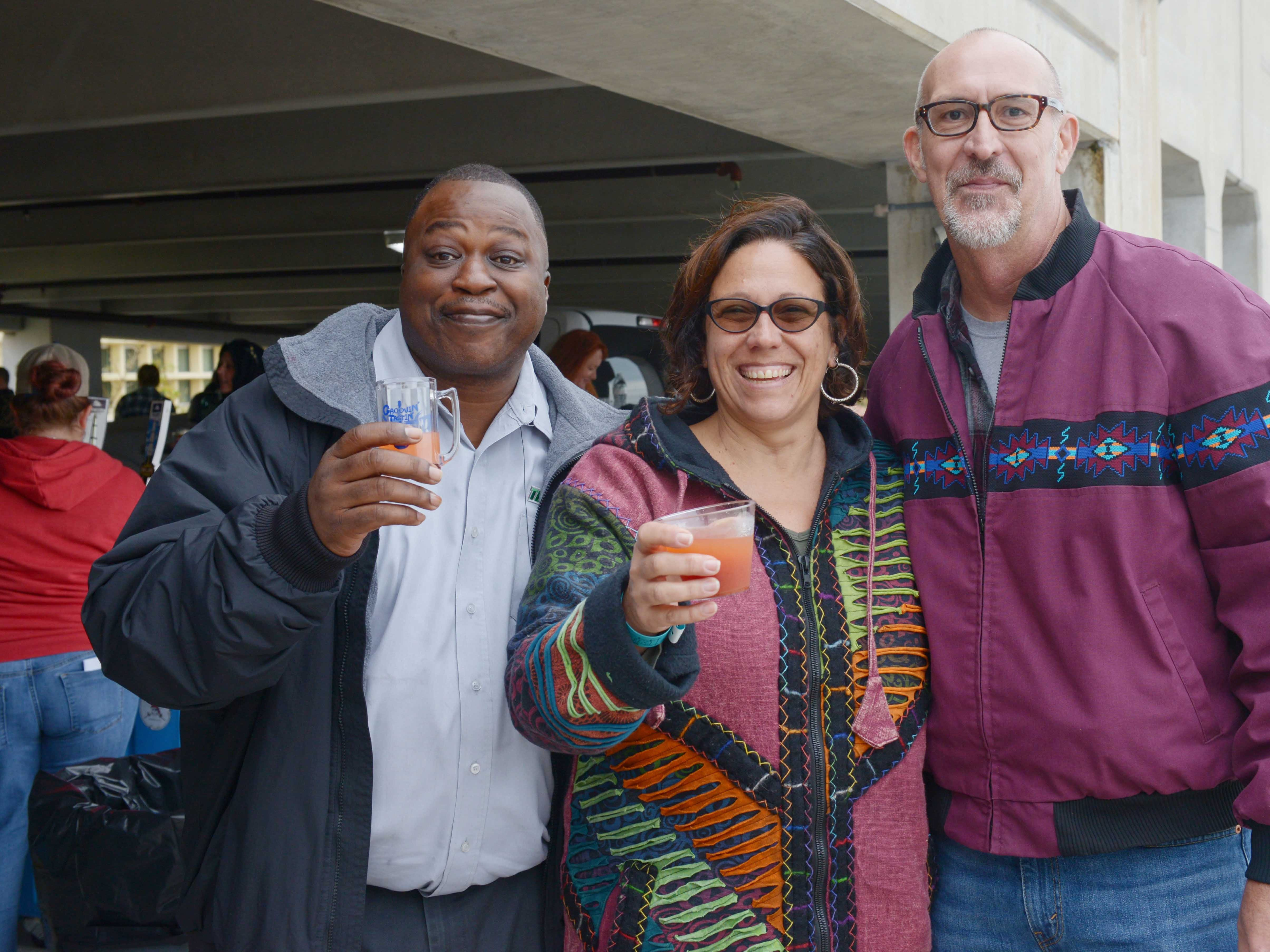 Alton Prater, left, and Leslie and Earl Taylor on the roof of the Fort Pierce City Parking Garage for Bluebird Educational Foundation's Groovin' & Tastin' Sunrise City Wine & Spirits Fest.