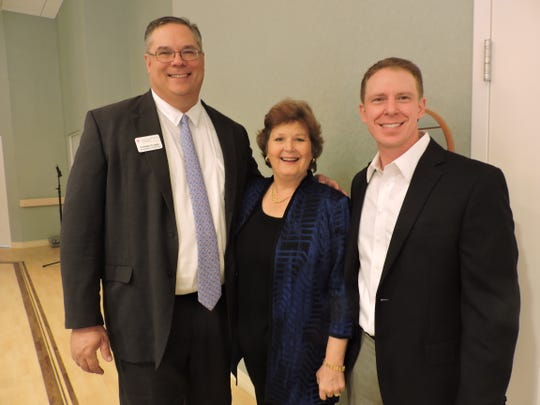 Murray Fournie, left, of Treasure Coast Health, with Martin County Estate Planning Council board members Carrie Lavargna and Ryan Furtwangler at the Jan. 23 symposium at The Kane Center in Stuart.
