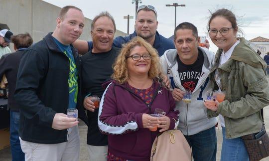Justin Cudnik, Kipp Ahrens, Roger LaMarca, Jenny and Pete O'Toole and Jessie Kruse at Bluebird Educational Foundation's Groovin' & Tastin' Sunrise City Wine & Spirits Fest.