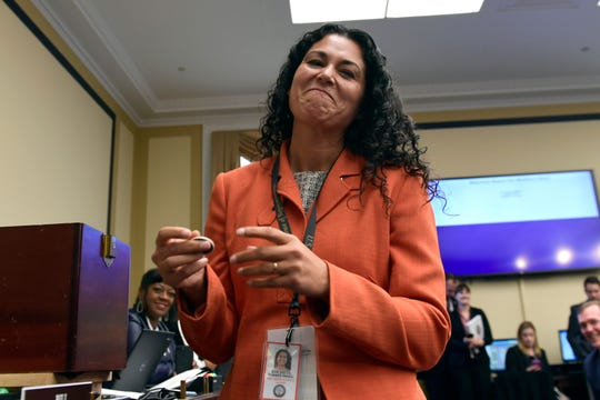 In this Nov. 30, 2018, photo, Rep.-elect Xochitl Torres Small, D-N.M., reacts after drawing her number during the member-elect room lottery draw on Capitol Hill in Washington.