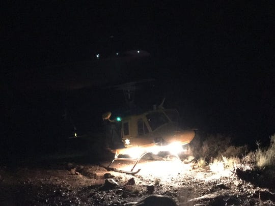 Ventura County's Air Squad 9 helicopter crew helped rescue three hikers stranded in Los Padres National Forest on Saturday night.