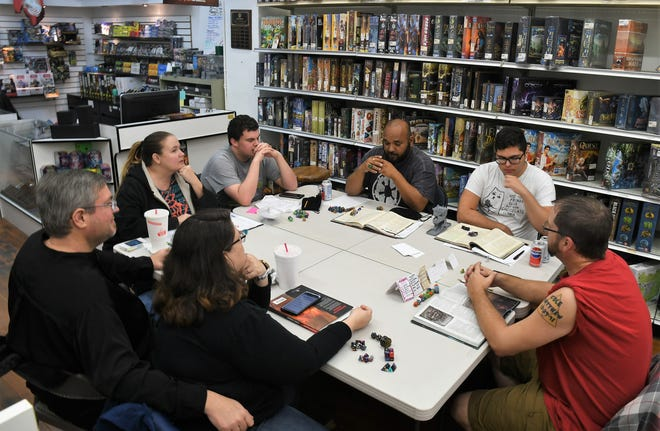 Dungeon master Adam Dowdy and his trusty Tulare County Adventurer's Guild skip the Super Bowl and gather at GameQore Visalia for their weekly Dungeons & Dragons session.