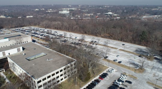 Drone photo of the proposed construction project site at 1133 Westchester Ave. in White Plains. Monday, February 4, 2019. The 20-acre Flats at Westchester apartment complex is proposed for the wooded area on the far side of the parking lot. If RPW Group's plan is approved and completed, the three five-story apartment buildings would have views of the Westchester County-owned Maple Moor Golf Course.