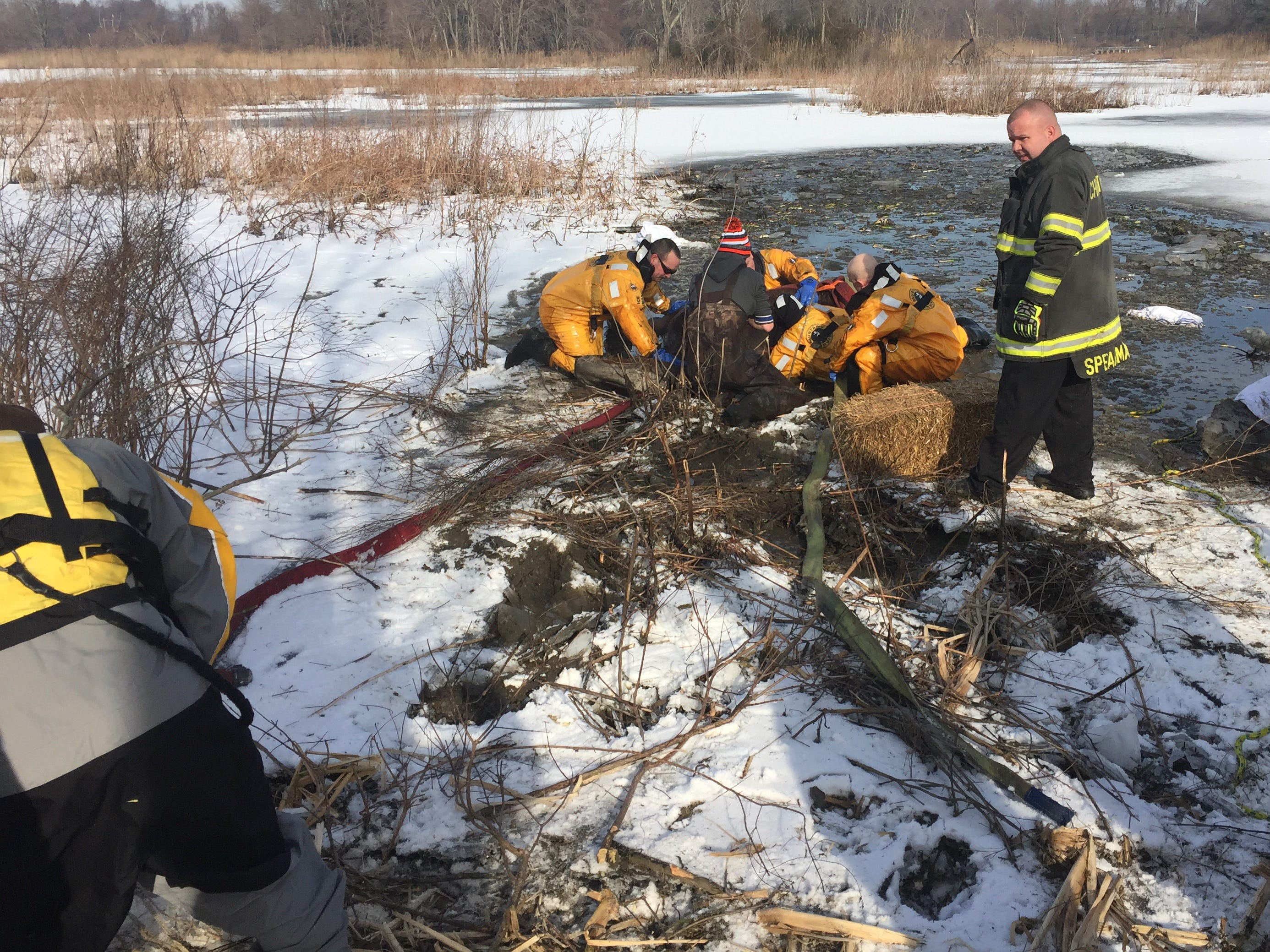 Members of the Delaware City Fire Company rescue a horse named Bubba from the thick marsh at Dragon Run Creek on Sunday.