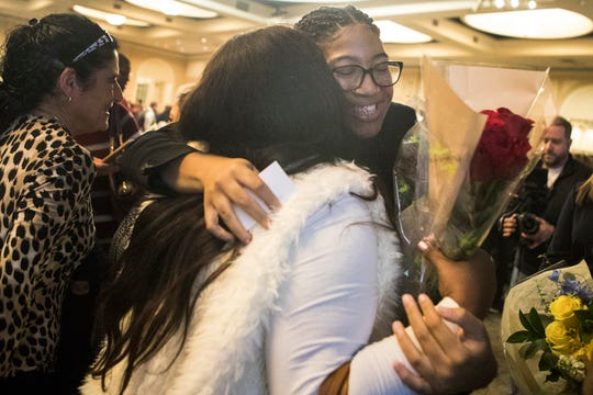 Saint Elizabeth High School senior Ardavia Lee hugs friends and family after being surprised with a $25,000 Bridging the Dream Scholarship from Sallie Mae Monday at the Chase Center.