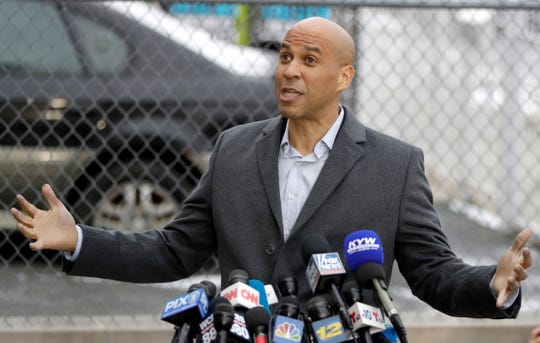 "U.S. Sen. Cory Booker, D-NJ, speaks during a news conference outside of his home, Friday, Feb. 1, 2019, in Newark, N.J. Booker earlier in the day declared his bid for the presidency with a sweeping call to unite a deeply polarized nation around a ""common purpose."""