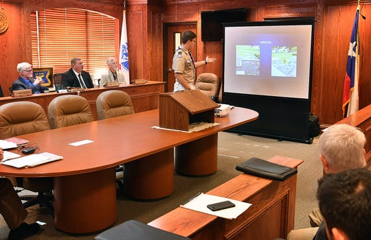 Boy Scout Colin Myers presents plans for his Eagle Scout project during Monday's meeting of the Wichita County Comissioners Court. The project would beautify an area around the Charlye O. Farris historical marker at the courthouse.
