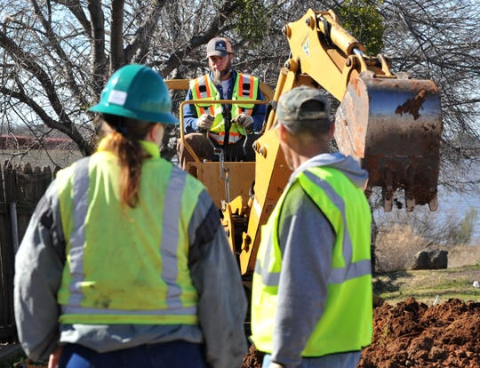 City of Wichita Falls park maintenance employee, Michael Sudol works to dig a trench to run plumbing to a fish cleaning station at the Lake Wichita boat ramp located on Kemp Blvd. Monday morning.