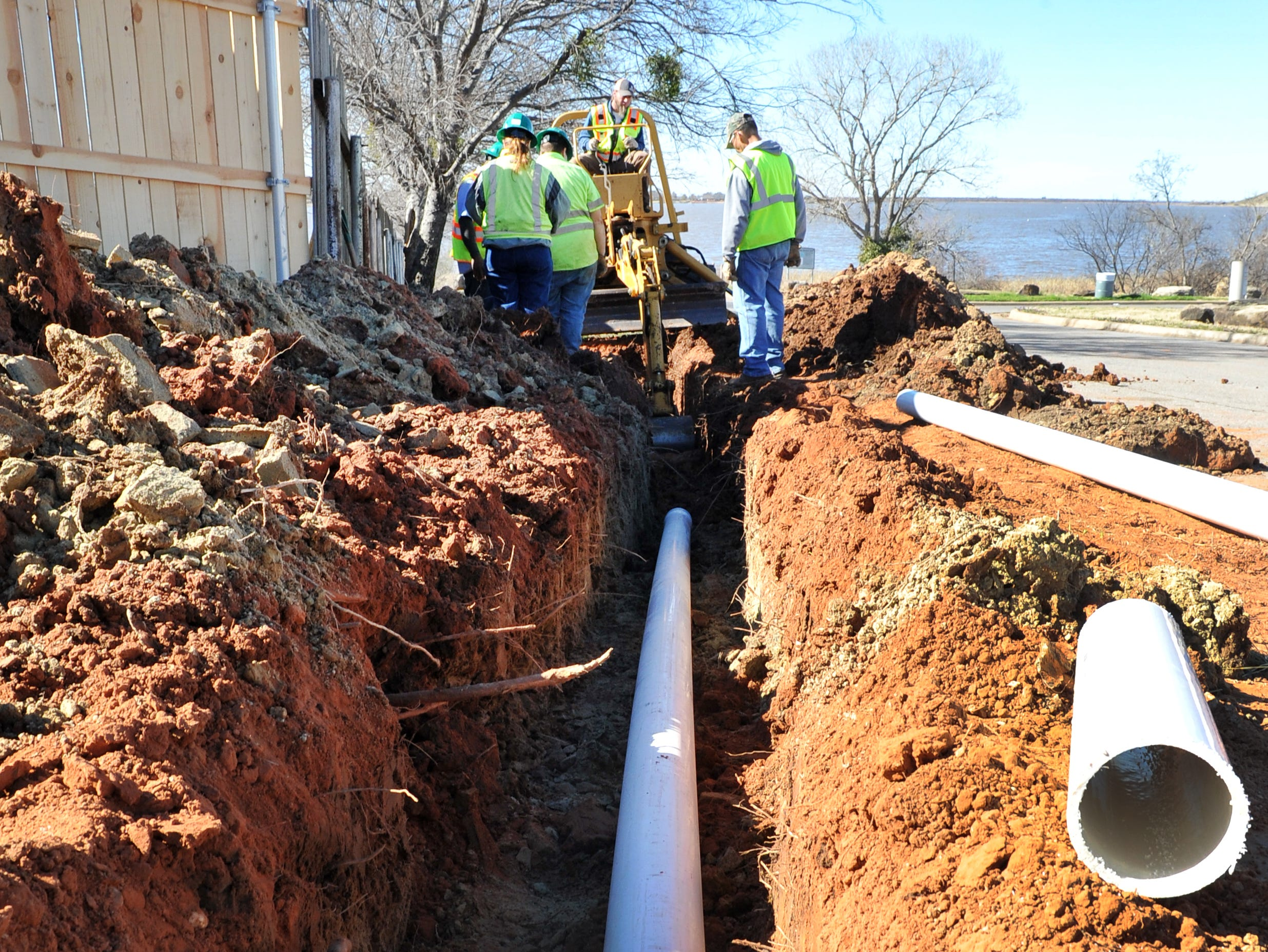 City of Wichita Falls park maintenance employees work dig a trench to run plumbing to a fish cleaning station at the Lake Wichita boat ramp located on Kemp Blvd. Monday morning.