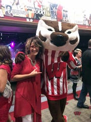 Auctioneer Jenny Markham-Gehl gets a photo with Bucky Badger during Bucky on Parade featuring 85 life-size Bucky Badger statues last year.