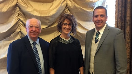 Wisconsin 2019 State Auctioneer Champion Jenny Markham-Gehl is pictured with her dad Jim Markham and brother Tim Markham. Tim was the Iowa state champion in 2014.