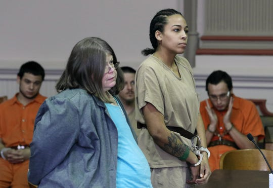 Brianna Dotson stands in Muskingum County Common Pleas Court during her arraignment for armed robbery on Monday.