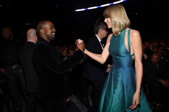 Kanye West and Taylor Swift greeting one another at the 2015 Grammys.