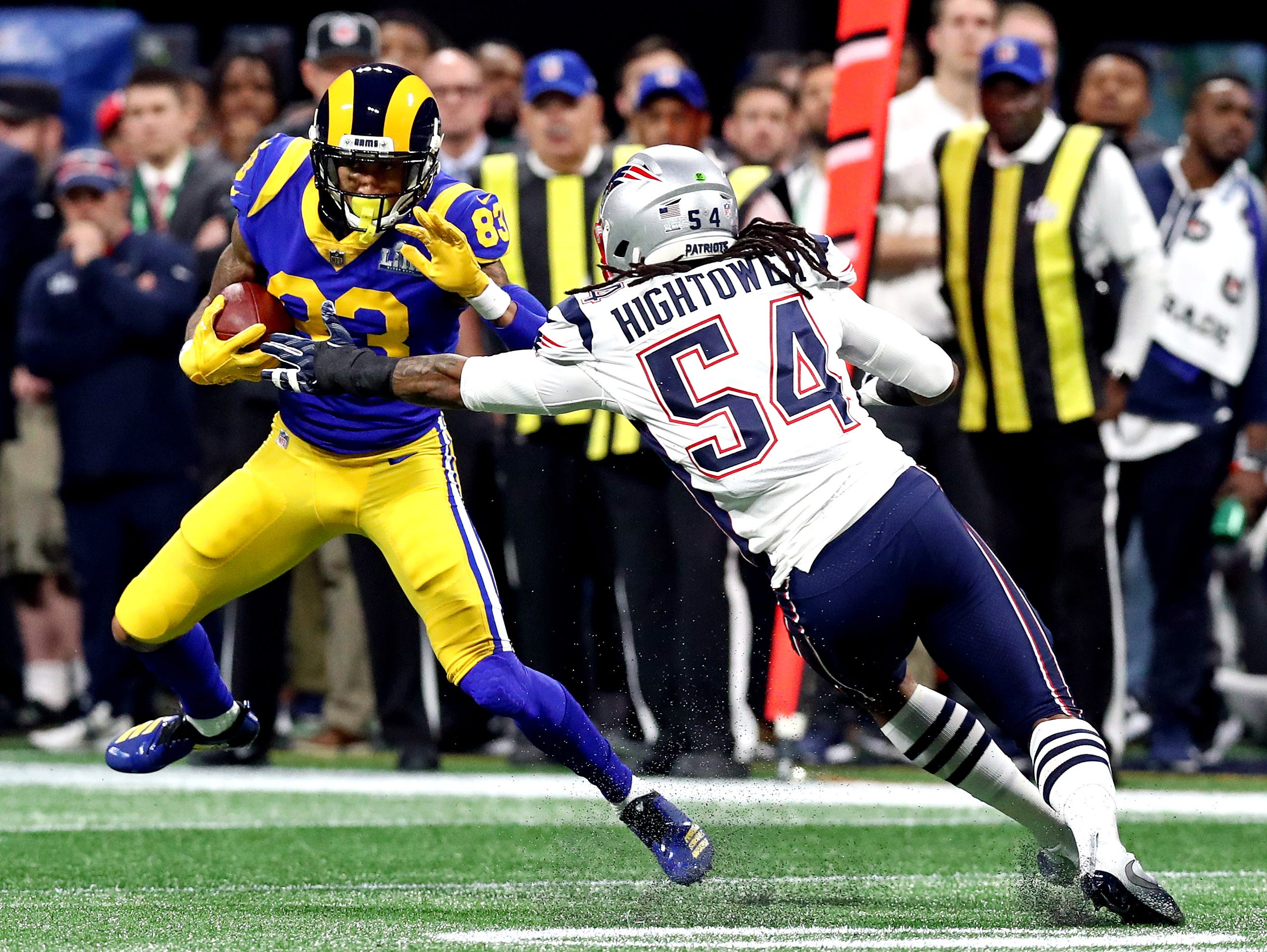 Los Angeles Rams wide receiver Josh Reynolds (83) runs the ball against New England Patriots outside linebacker Dont'a Hightower (54) during the first quarter of Super Bowl LIII.