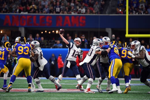 New England Patriots quarterback Tom Brady (12) drops back to pass against the Los Angeles Rams during the second quarter of Super Bowl LIII at Mercedes-Benz Stadium.