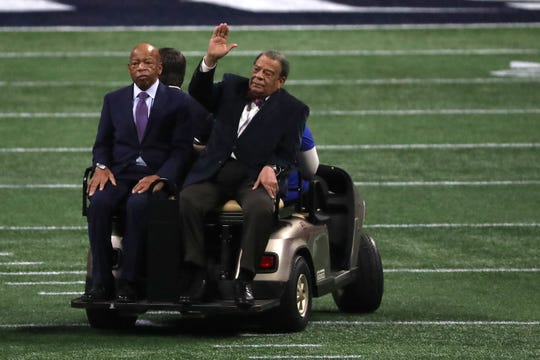 U.S. Rep. John Lewis and former U.S. ambassador to the United Nations Andrew Young arrive prior to Super Bowl LIII between the New England Patriots and the Los Angeles Rams at Mercedes-Benz Stadium on February 03, 2019 in Atlanta, Georgia.