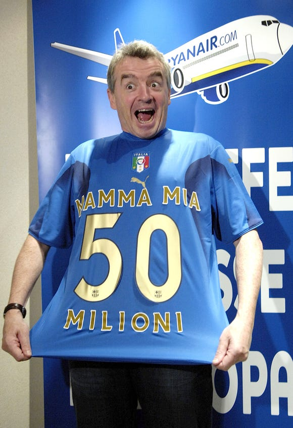 In this file photo from October 2017, Ryanair CEO Michael O'Leary shows a jersey celebrating the company's goal of flying 50 million passengers on Italian routes during a news conference in Milan, Italy.