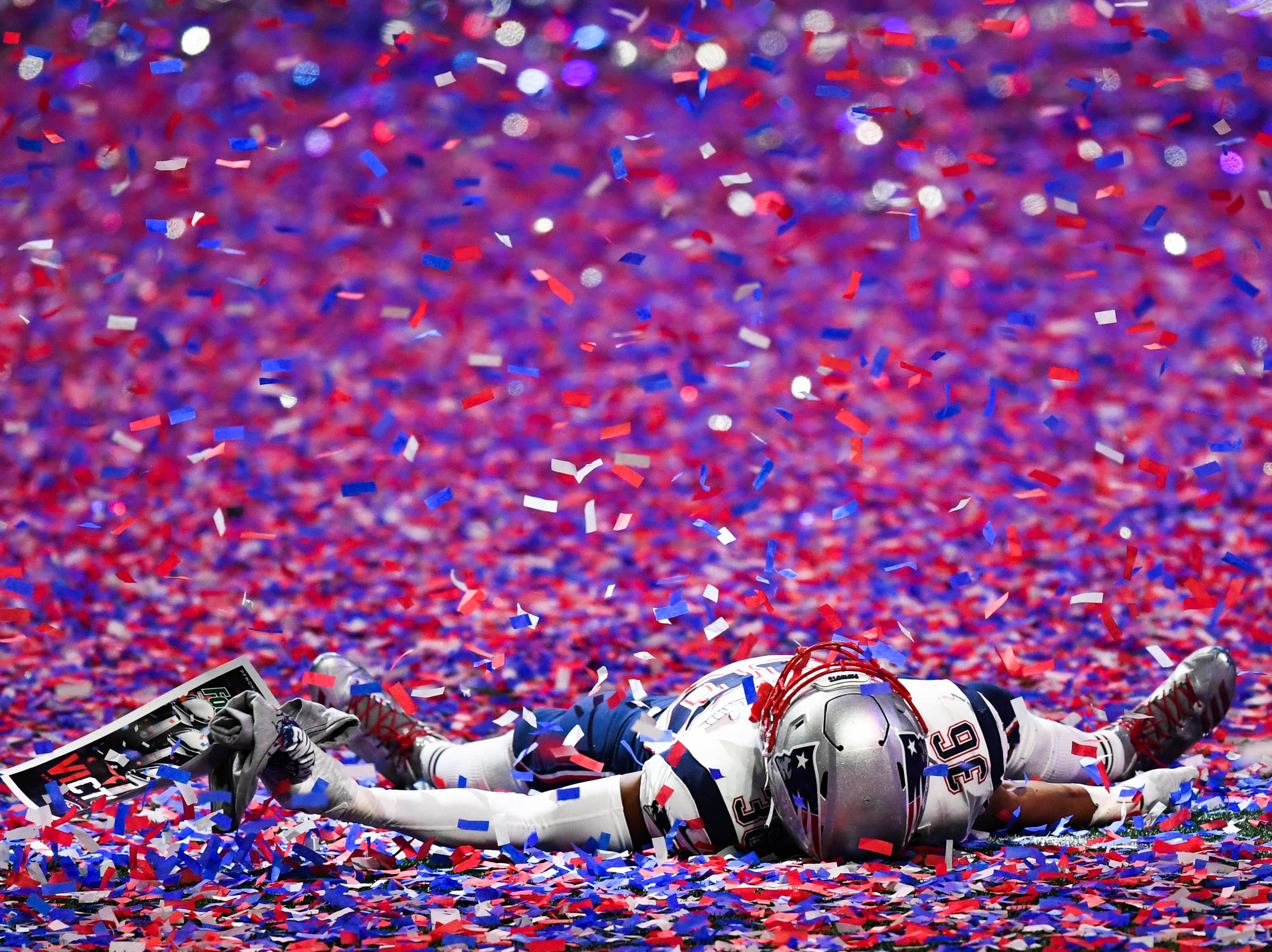 New England Patriots middle linebacker Brandon King (36) lays in the confetti at Mercedes-Benz Stadium after a 13-3 victory over the Los Angeles Rams in Super Bowl LIII.