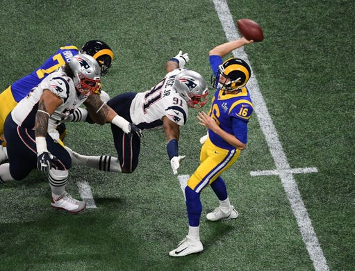 New England Patriots defensive end Deatrich Wise (91) bears down on Los Angeles Rams quarterback Jared Goff (16) during the first quarter of Super Bowl LIII.