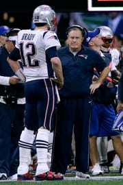 Patriots QB Tom Brady talks with head coach Bill Belichick during Super Bowl LIII.