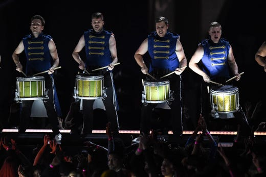 Marching band drummers perform during the Super Bowl LIII halftime show at Mercedes-Benz Stadium.