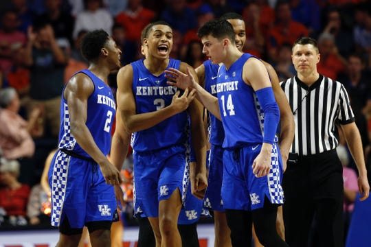Kentucky Wildcats guard Keldon Johnson (3), guard Ashton Hagans (2), guard Tyler Herro (14), forward PJ Washington (25) celebrate against the Florida Gators during the second half at Exactech Arena.