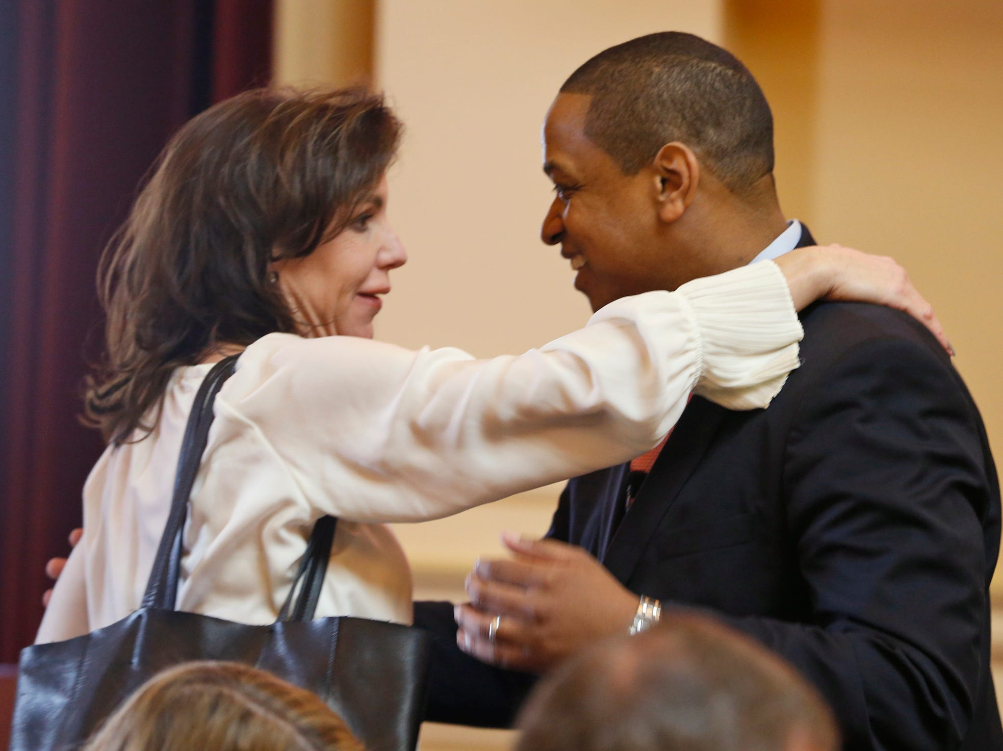 Fairfax, right, gets a hug from State Sen. Jill Vogel, R-Fauquier, left, after he presided over his first Senate session at the Capitol in Richmond, Va., on  Jan. 15, 2018. Vogel lost last year's election to Fairfax.