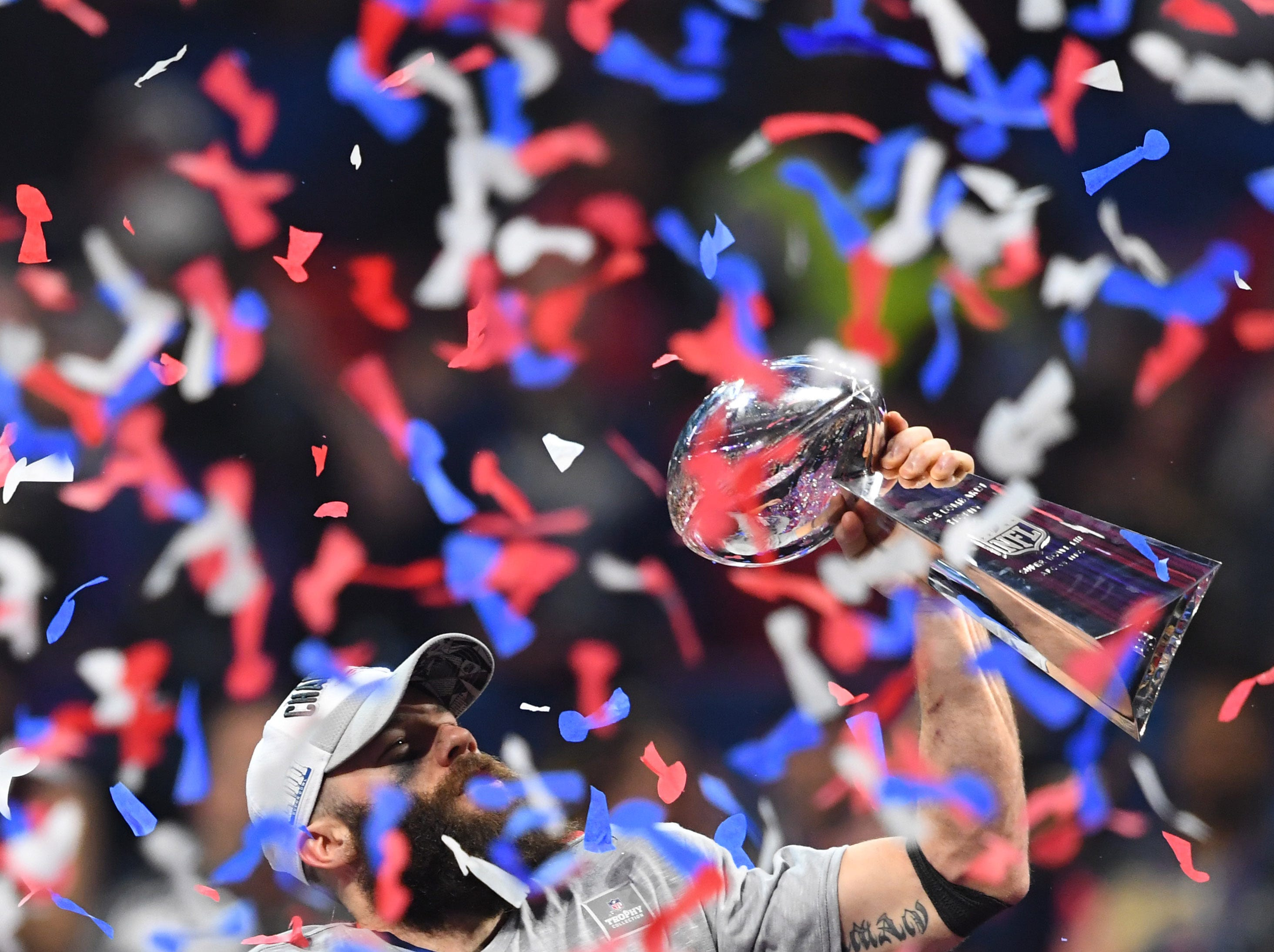 Wide receiver Julian Edelman, lifting the Vince Lombardi trophy, was named Most Valuable Player of Super Bowl LIII.