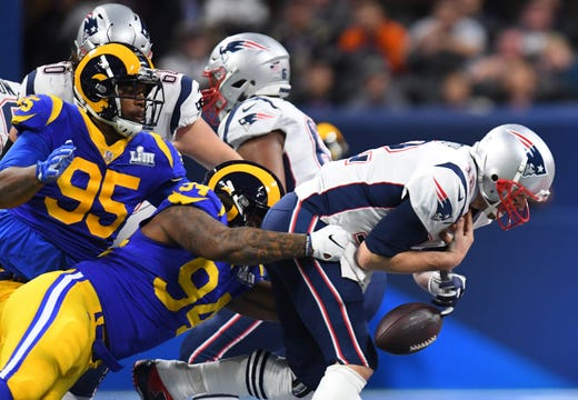Los Angeles Rams defensive end John Franklin-Myers (94) sacks New England Patriots quarterback Tom Brady (12), who fumbles the ball, during the first quarter of Super Bowl LIII. The Patriots recovered the fumble.