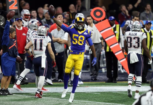 Los Angeles Rams inside linebacker Cory Littleton (58) celebrates after intercepting a pass from New England Patriots quarterback Tom Brady (not pictured) during the first quarter of Super Bowl LIII at Mercedes-Benz Stadium.