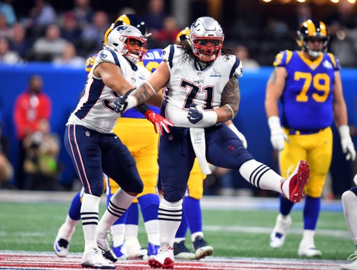 New England Patriots defensive tackle Danny Shelton (71) celebrates a defensive stop during the second quarter of Super Bowl LIII against the Los Angeles Rams.