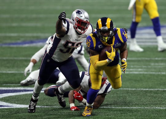 Todd Gurley is chased by Elandon Roberts during the fourth quarter in Super Bowl LIII at Mercedes-Benz Stadium.