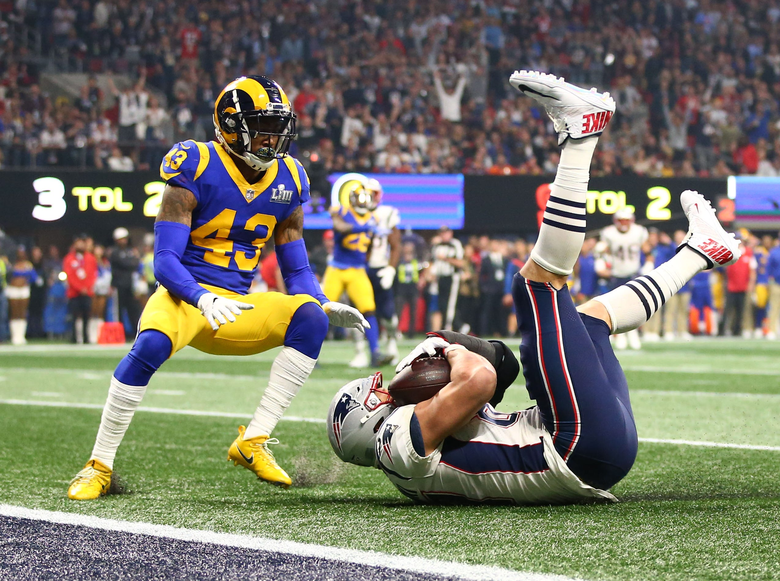 New England Patriots tight end Rob Gronkowski (87) catches a pass near the goal line against Los Angeles Rams strong safety John Johnson (43) in the fourth quarter of Super Bowl LIII.