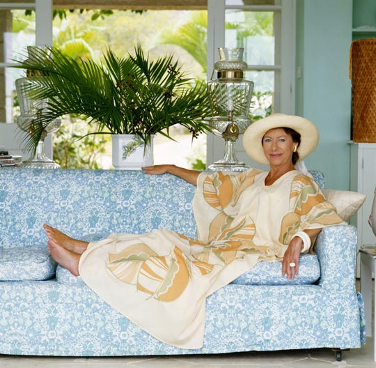 Princess Margaret reclining on a sofa at her home, Les Jolies Eaux, on Mustique in April 1976.