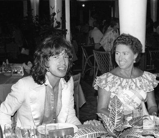Princess Margaret chats in a restaurant in Pointe-du-Bout, French West Indies, with Rolling Stone rocker Mick Jagger in December 1976.