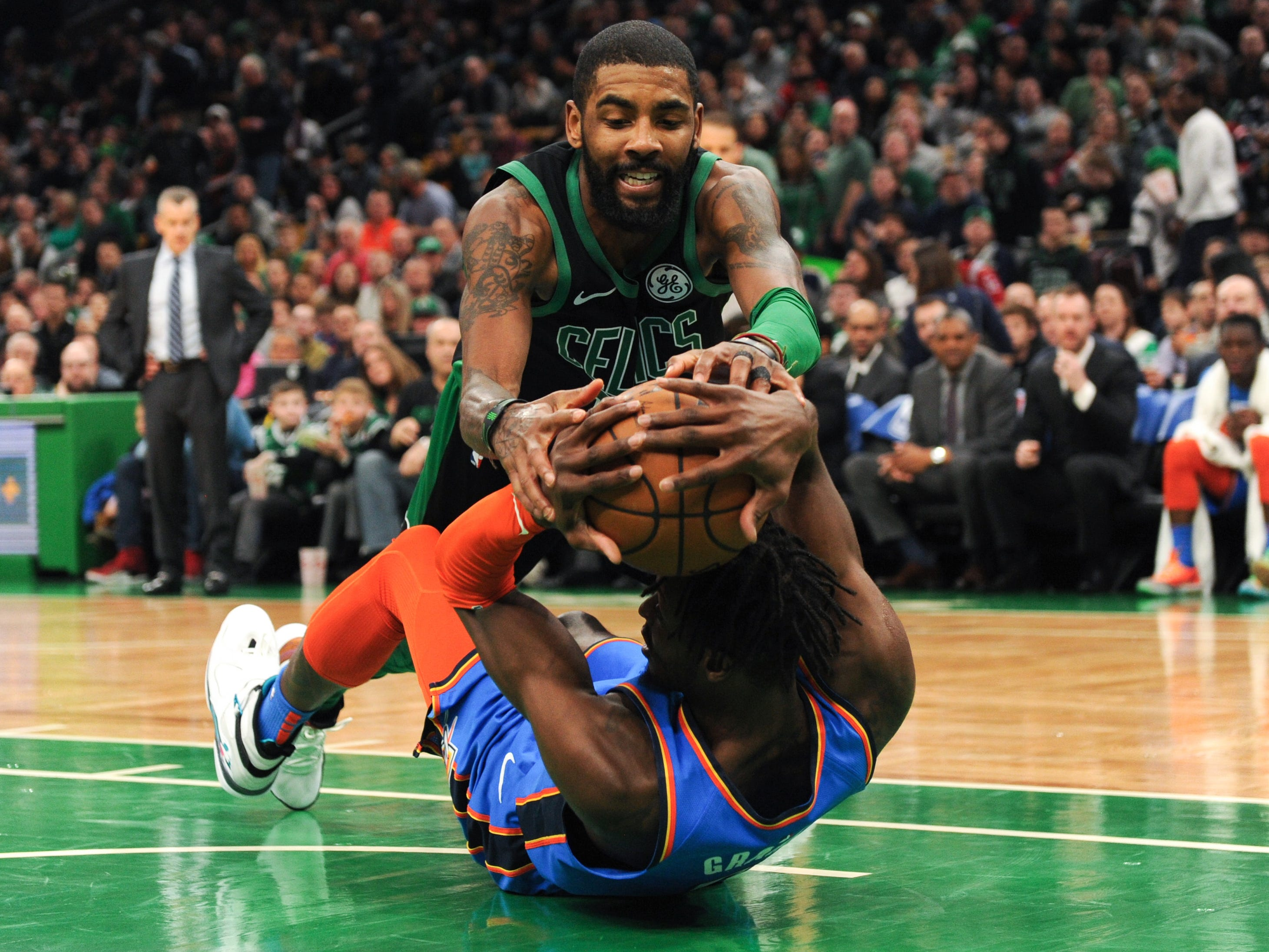 Feb. 3: Celtics guard Kyrie Irving and Thunder forward Jerami Grant hit the deck while fighting for a loose ball during the second half in Boston.