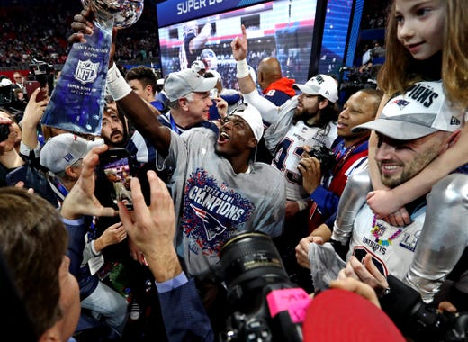 The New England Patriots celebrate with the Vince Lombardi Trophy after beating the Los Angeles Rams 13-3 in Super Bowl LIII at Mercedes-Benz Stadium in Atlanta.