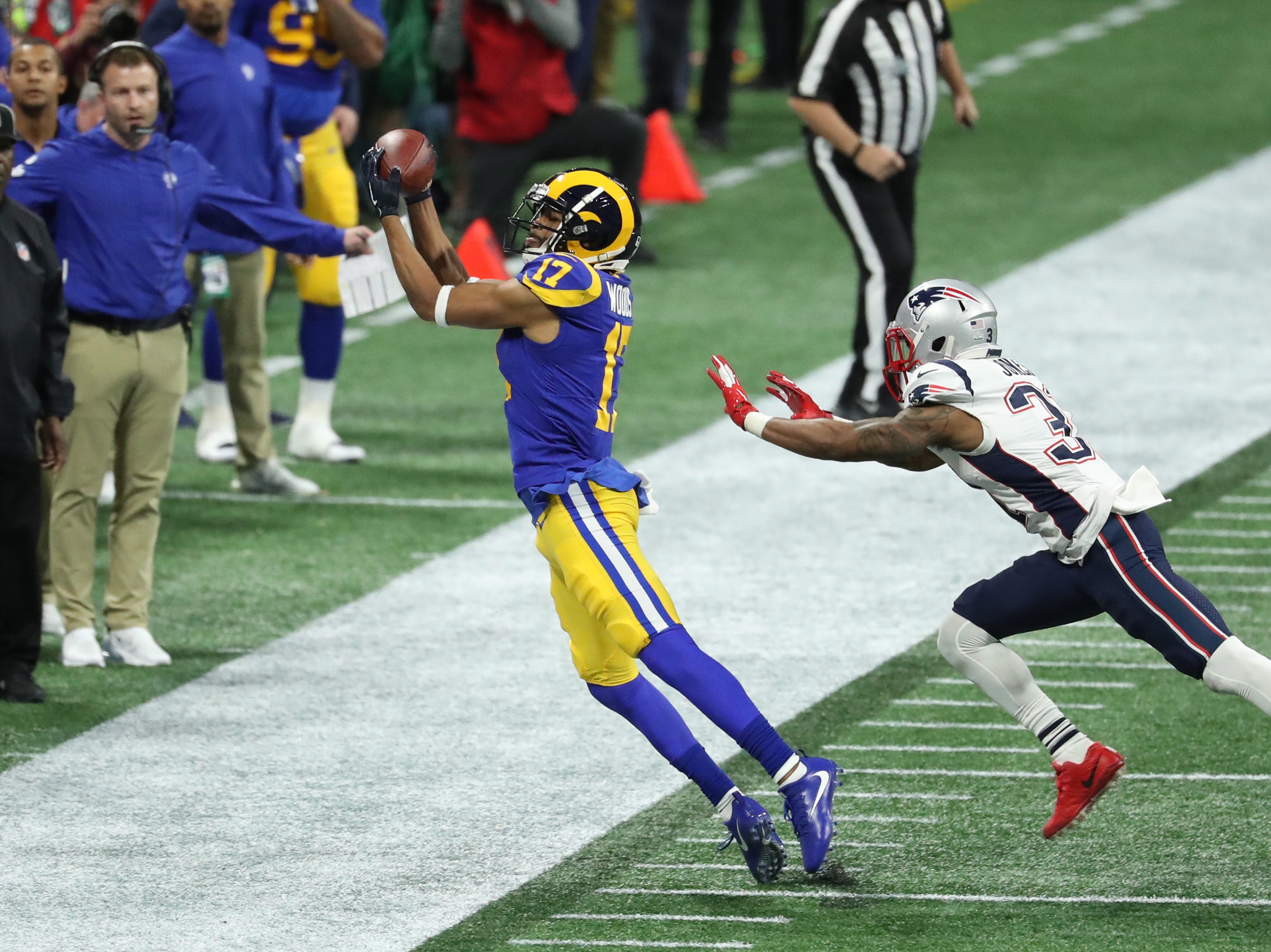 Los Angeles Rams wide receiver Robert Woods (17) catches a pass against New England Patriots defensive back Jonathan Jones (31) and gets both feet inbounds during the second quarter of Super Bowl LIII.