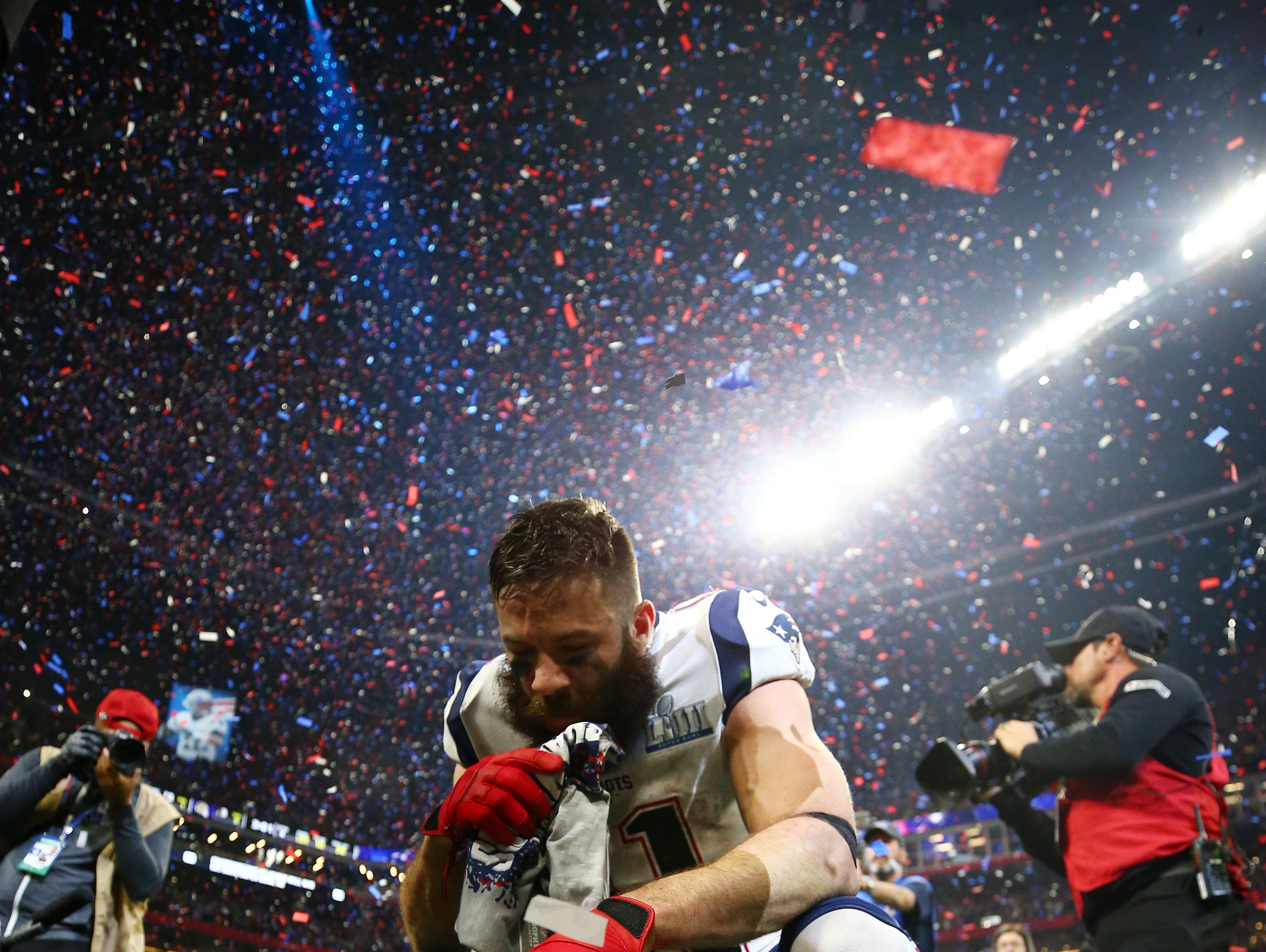 Wide receiver Julian Edelman (11) celebrates on the field after leading the New England Patriots to a 13-3 win over the Los Angeles RAms in Super Bowl LIII.