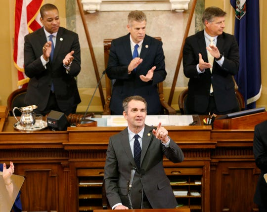 Virginia Gov. Ralph Northam delivers his State of the Commonwealth address as Lt. Gov. Justin Fairfax, top left, House Speaker Kirk Cox, R-Colonial Heights, top center, and Senate President Pro Tem Stephen Newman, R-Botetourt, applaud during a joint session of the Virginia Legislature in the House chambers at the Capitol in Richmond, Va., on Jan. 9, 2019.