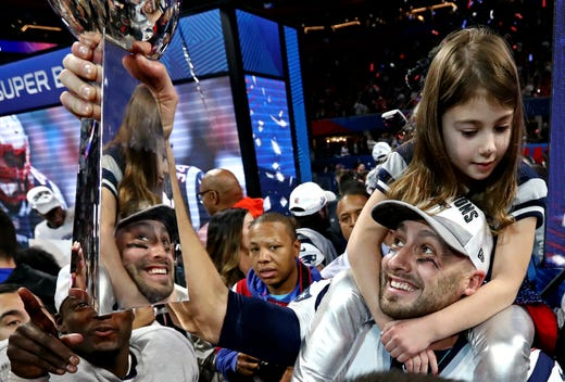 New England Patriots backup quarterback Brian Hoyer (2) celebrates with the Vince Lombardi Trophy after the team's 13-3 win in Super Bowl LIII.