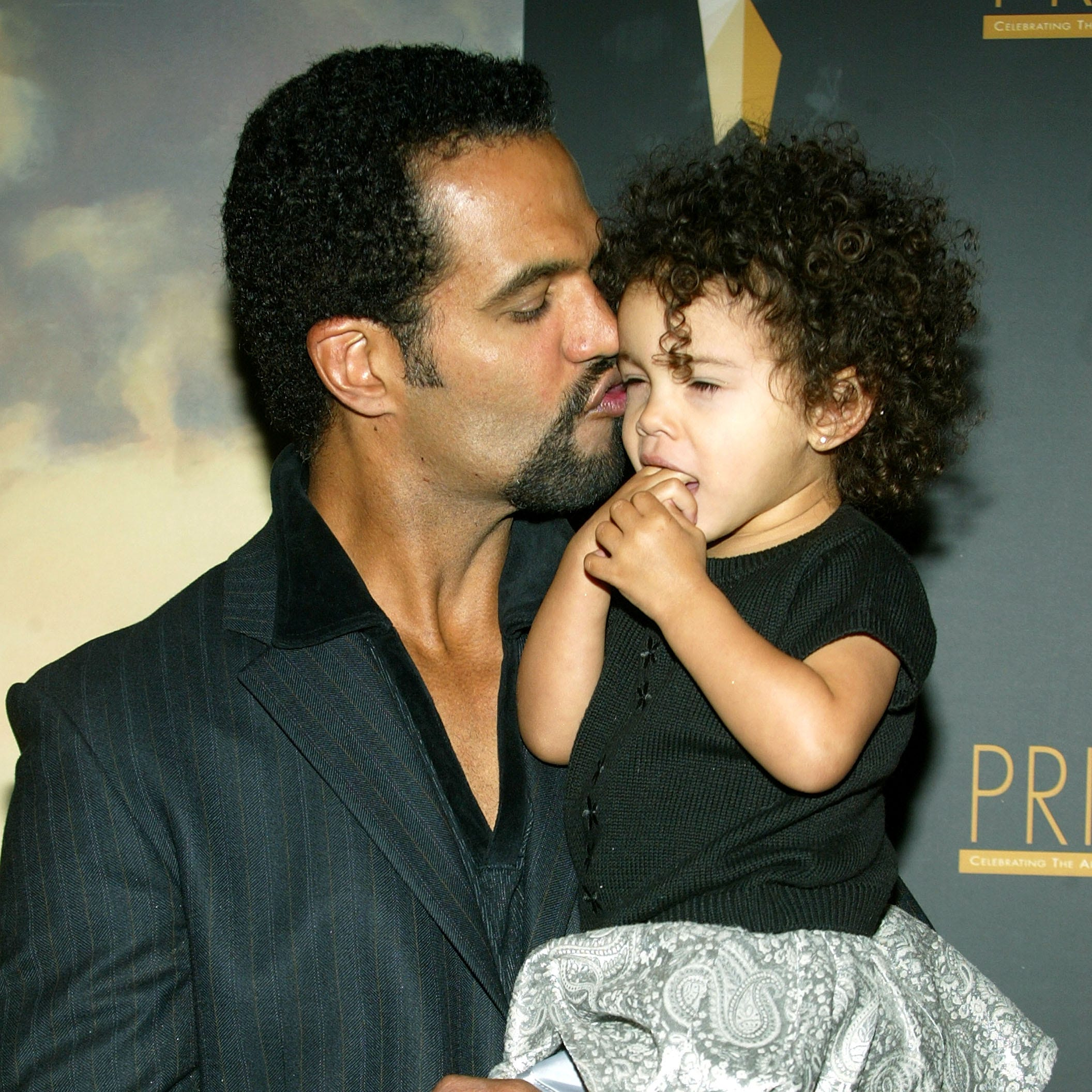 Kristoff St. John poses with daughter Lola as they arrive at the 9th Annual PRISM Awards, April 28, 2005 in Beverly Hills, Calif.