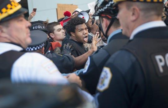 Demonstrators clashed with police on December 9, 2015 in Chicago, Illinois. About 1,000 protestors called for the resignation of Chicago Mayor Rahm Emanuel, who came under fire as allegations of extreme misconduct on the Chicago Police Department continued to surface.