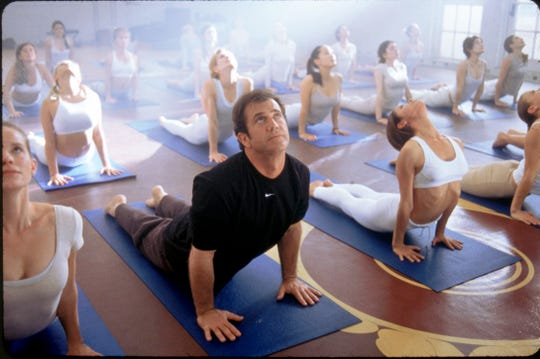 "Mel Gibson's advertising executive enrolls in an all-female yoga class after realizing he can read women's minds in ""What Women Want."""