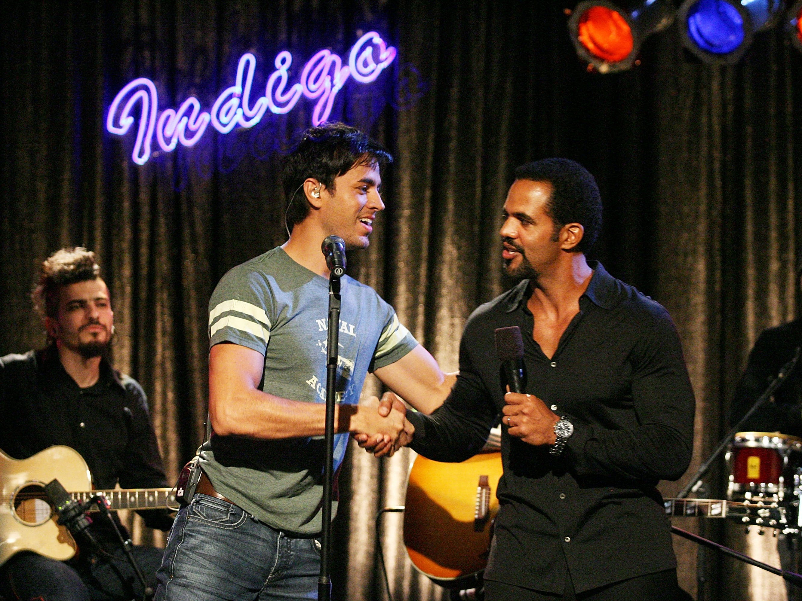 "Recording artist Enrique Iglesias and actor Kristoff St. John perform during an appearance on the television show ""The Young And The Restless,"" Oct. 11, 2007 in Los Angeles."