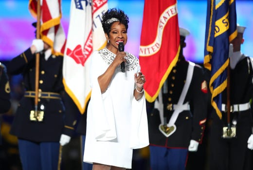 Legendary singer Gladys Knight performs the national anthem before Super Bowl LIII between the New England Patriots and the Los Angeles Rams at Mercedes-Benz Stadium.