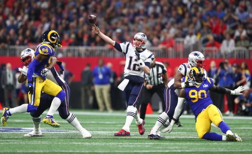 New England Patriots quarterback Tom Brady (12) throws a pass against the Los Angeles Rams in the first quarter in Super Bowl LIII.